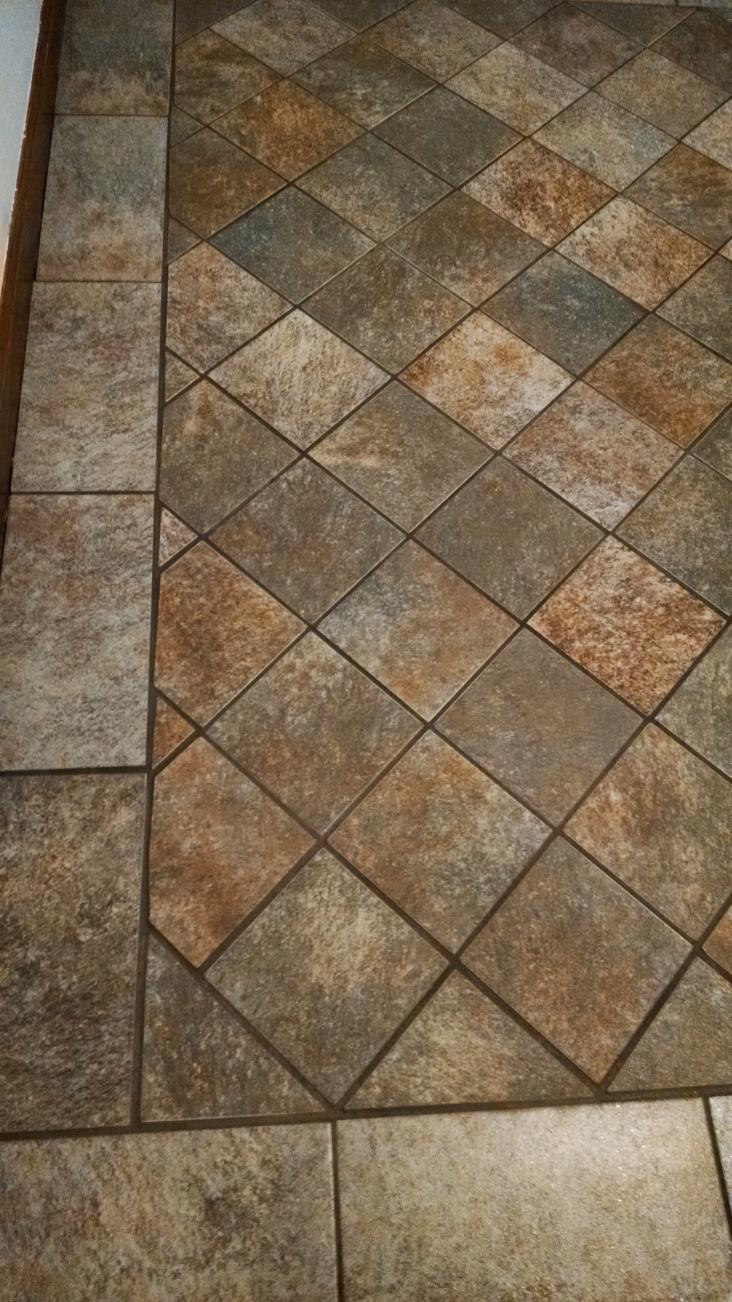 We install tile north kansas city remodeling floor tile installing floor tile remodeling kansas city northland dailygadgetfo Image collections